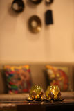 Meditation Lamps. Two aromatic lamps made of gold, lit up in a meditation room Stock Photos