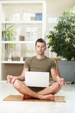 Meditation with laptop computer Royalty Free Stock Image