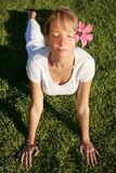 Meditation on a Lawn. Woman in white meditating on a green lawn Royalty Free Stock Image