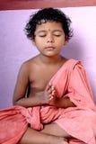 Meditation. A little girl doing meditation for photographs stock images