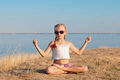 Meditation in lotus position Royalty Free Stock Photos