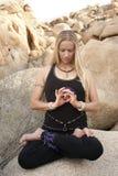 Meditation Mandala. Woman in yoga pose Lotus focused on the drishti of her interlocked circular hand mudra sitting in lotus pose in a natural environment. The Royalty Free Stock Photos