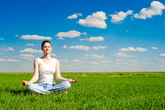Meditation on the meadow. Over the blue sky Stock Image