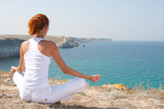 Meditation in mountains Stock Images