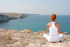 Meditation in mountains royalty free stock images