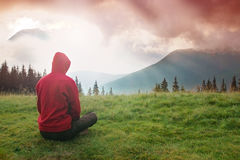 Meditation in the Mountains. Man meditating in the mountains during the dawn Royalty Free Stock Photography