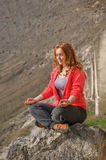 Meditation in mountains Royalty Free Stock Photography