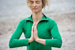 Meditation In Nature. Meditation Of A Mature Blond Woman Near Water Stock Photos