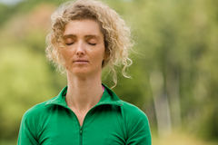 Meditation In Nature. Portrait Of A Mature Blond Woman Meditating In Nature Royalty Free Stock Photos