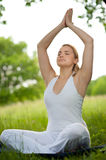 Meditation in nature - girl meditates Royalty Free Stock Photography