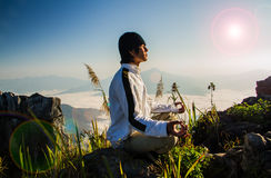 Meditation in nature. Meditation on  top of the mountain when sunrise Stock Photo