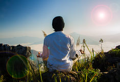 Meditation in nature. Meditation on  top of the mountain when sunrise Royalty Free Stock Photos
