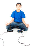 Meditation near joysticks Royalty Free Stock Photo