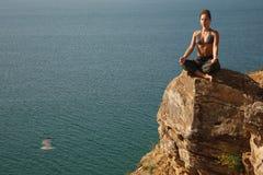 Meditation near water Royalty Free Stock Photo