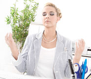 Meditation at office during lunch. Meditation during the lunch break - business woman relaxes Royalty Free Stock Photo
