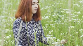 Meditation outdoors, beautiful woman sits in lotus pose closed eyes female field. Stock footage stock footage