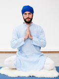 Meditation. Portrait of a young bearded man in a turban Royalty Free Stock Photography
