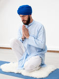Meditation. Portrait of a young bearded man in a turban Stock Image
