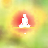 Meditation pose Blurred floral background Royalty Free Stock Image