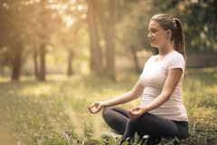 Meditation. Pregnant woman having meditation in nature. Copy space royalty free stock photography