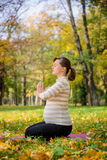 Meditation - pregnant woman outdoor Royalty Free Stock Image