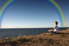 Meditation with rainbow Royalty Free Stock Photo