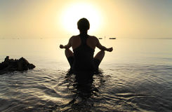 Meditation in Red Sea at sunrise Stock Photos