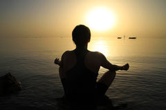 Meditation in Red Sea at sunrise Stock Photo