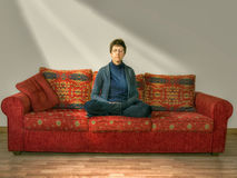 Meditation, relaxation. Mature, older woman at home on sofa, set Stock Photo