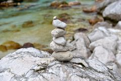 Meditation by the river. Meditation stones by the riverside Royalty Free Stock Photo