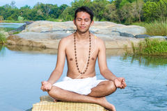 Meditation by the river Royalty Free Stock Image