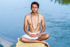 Meditation by the river Stock Photos