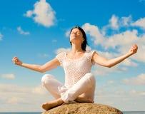 Meditation on a rock Royalty Free Stock Photo