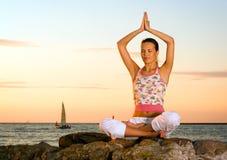 Meditation on rocks. Stock Photo