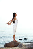Meditation on sand beach Royalty Free Stock Images