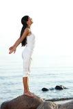 Meditation on sand beach Royalty Free Stock Photos
