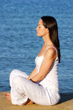 Meditation by the sea. Woman meditating by the sea Royalty Free Stock Photos