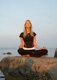 Meditation at the seashore. Fit girl meditating at the seashore Royalty Free Stock Photo