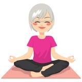 Meditation Senior Yoga. Beautiful senior adult woman practicing yoga meditation on lotus posture Stock Images