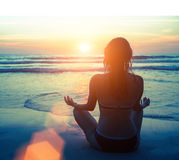 Meditation, serenity and yoga practicing at amazing sunset. Nature. Stock Photo