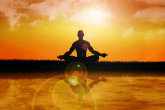 Meditation. Silhouette of a man figure meditating in the nature Stock Image