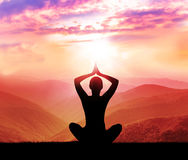 Meditation. Silhouette of man in the mountain. Yoga and meditation. Silhouette of man in the mountain stock photography