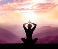 Meditation. Silhouette of man in the mountain Stock Photography