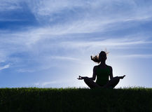 Meditation. Silhouette of young woman meditation in the park Royalty Free Stock Photos