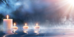 Meditation In Spiritual Zen Scenery. Candles On Thermal Water Stock Photography