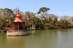 Meditation Stand. Oriental mediationstand on the middle of an public garden lake Stock Photos