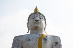 Meditation straight. Meditation front view of a large Buddha statue white Royalty Free Stock Photography