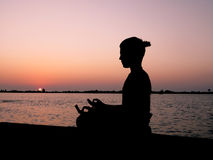Meditation at sunset Stock Image
