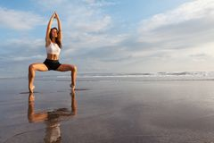 Fitness on sunset beach Royalty Free Stock Images