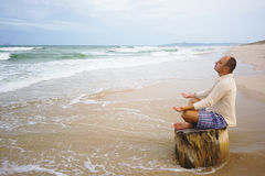 Meditation at sunset time Royalty Free Stock Photos